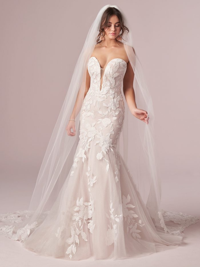 Model Wearing Strapless Mermaid Wedding Dress with Lace Trimmed Wedding Veil Called Hattie by Rebecca Ingram