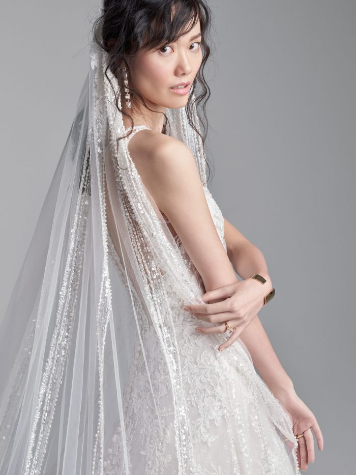 Bride Wearing Halter Neck A-line Wedding Dress with Cathedral Wedding Veil Called Rooney by Sottero and Midgley
