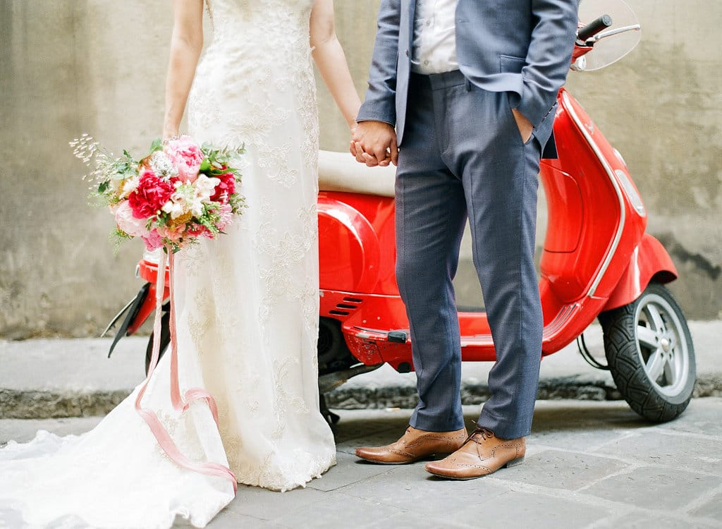 Groom with Real Bride in Front of Vespa at Real Wedding in Florence Italy