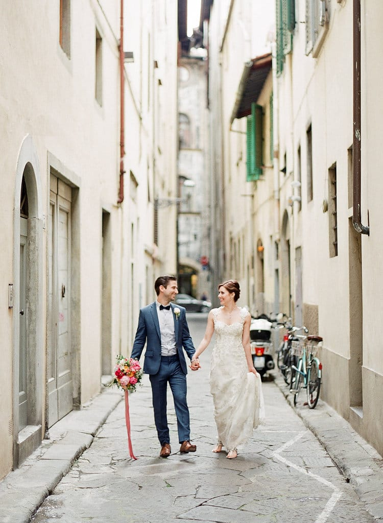 Bride and Groom Walking the Streets of Florence Italy for Destination Wedding