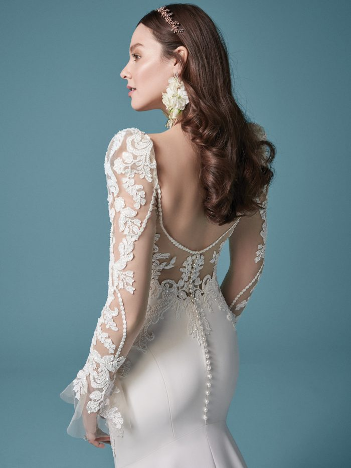 Bride Wearing Unique Crepe Sheath Wedding Dress Called Nikki Made by Maggie Sottero