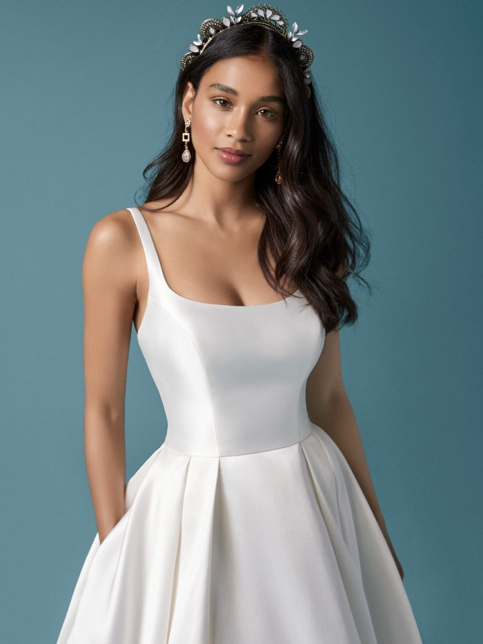 Model Wearing Satin Ball Gown Wedding Dress with Pockets Called Selena Made by Maggie Sottero