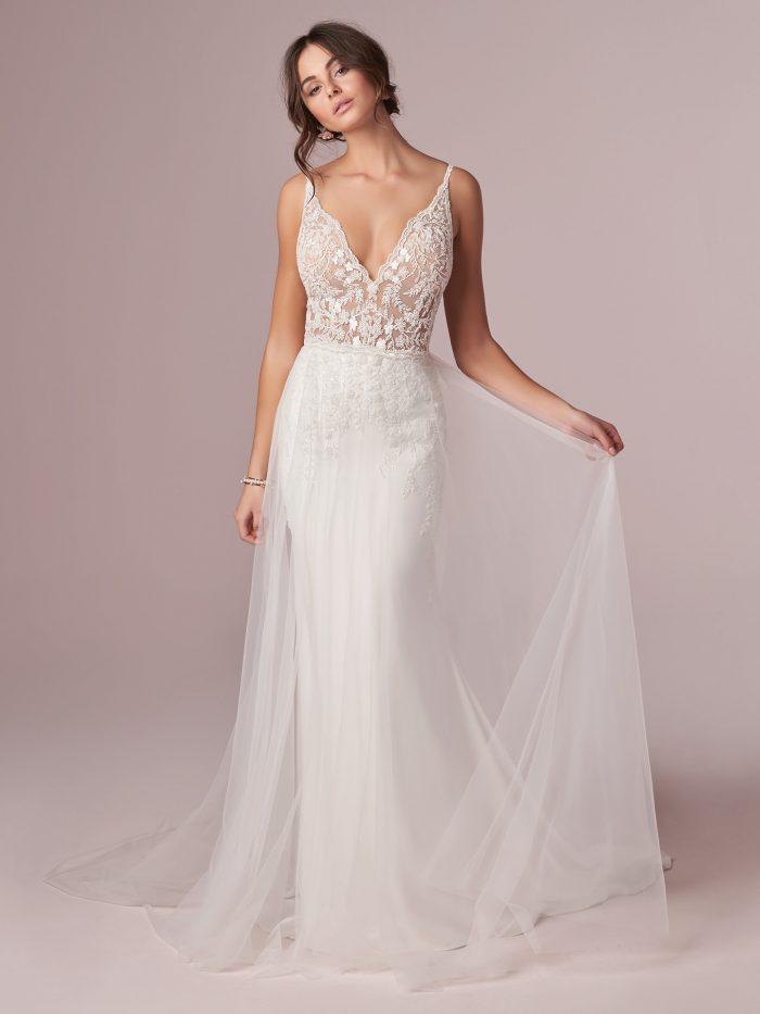 Model Wearing Sexy Sheath Wedding Dress with Sheer Overskirt Called Carmen by Rebecca Ingram