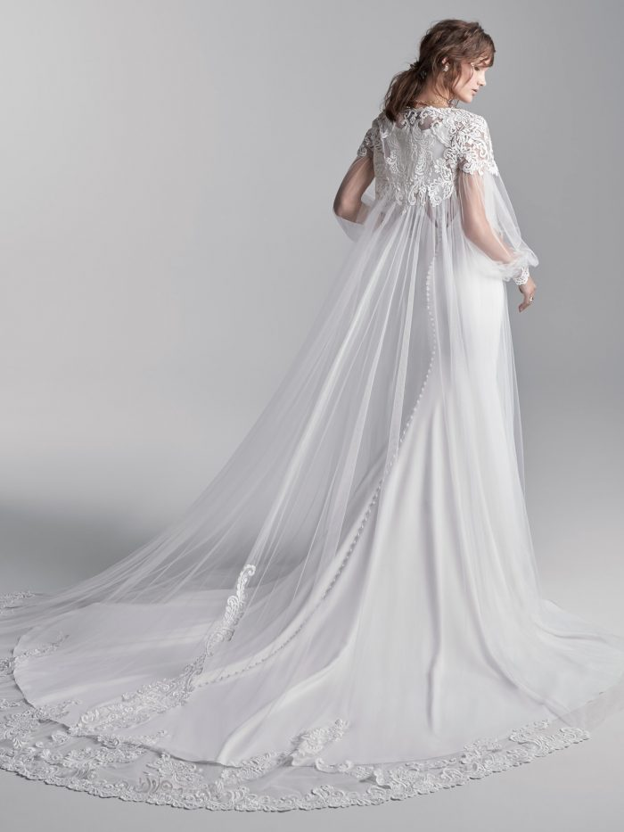 Model Wearing Simple Halter Back Bridal Dress Called Anthony by Sottero and Midgley with Sheer Cape