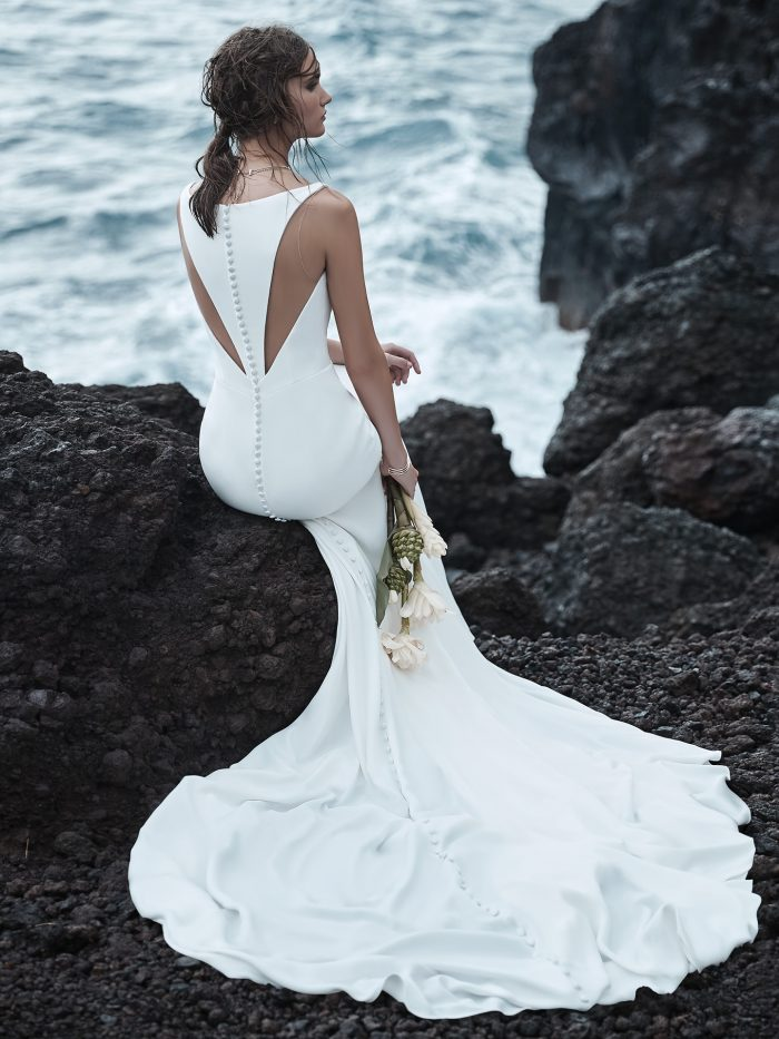 Model on Beach Simple Halter Back Bridal Dress Called Anthony by Sottero and Midgley