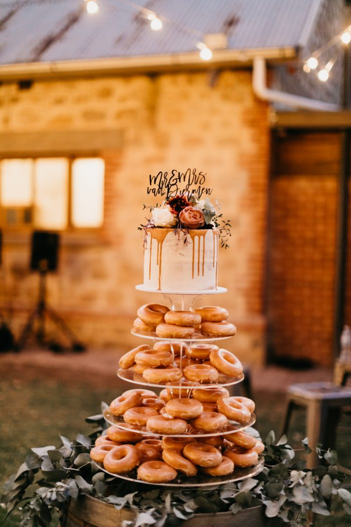 Small One Tier Wedding Cake with Donuts Underneath on Stand for Fall Wedding