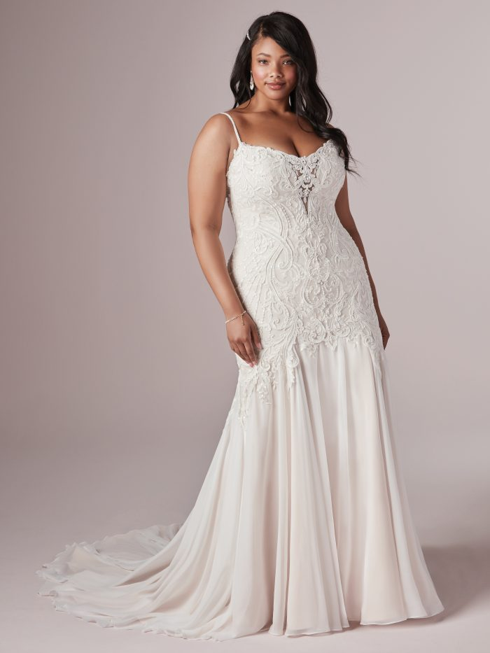 Model Wearing Plus Size Blush Wedding Gown Called Corrine by Rebecca Ingram
