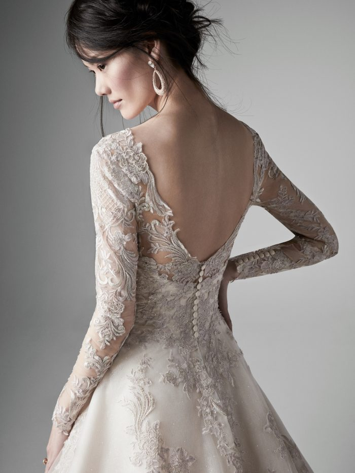 Bride Wearing Colored Wedding Dress with Pewter Accents Called Vincent by Sottero and Midgley