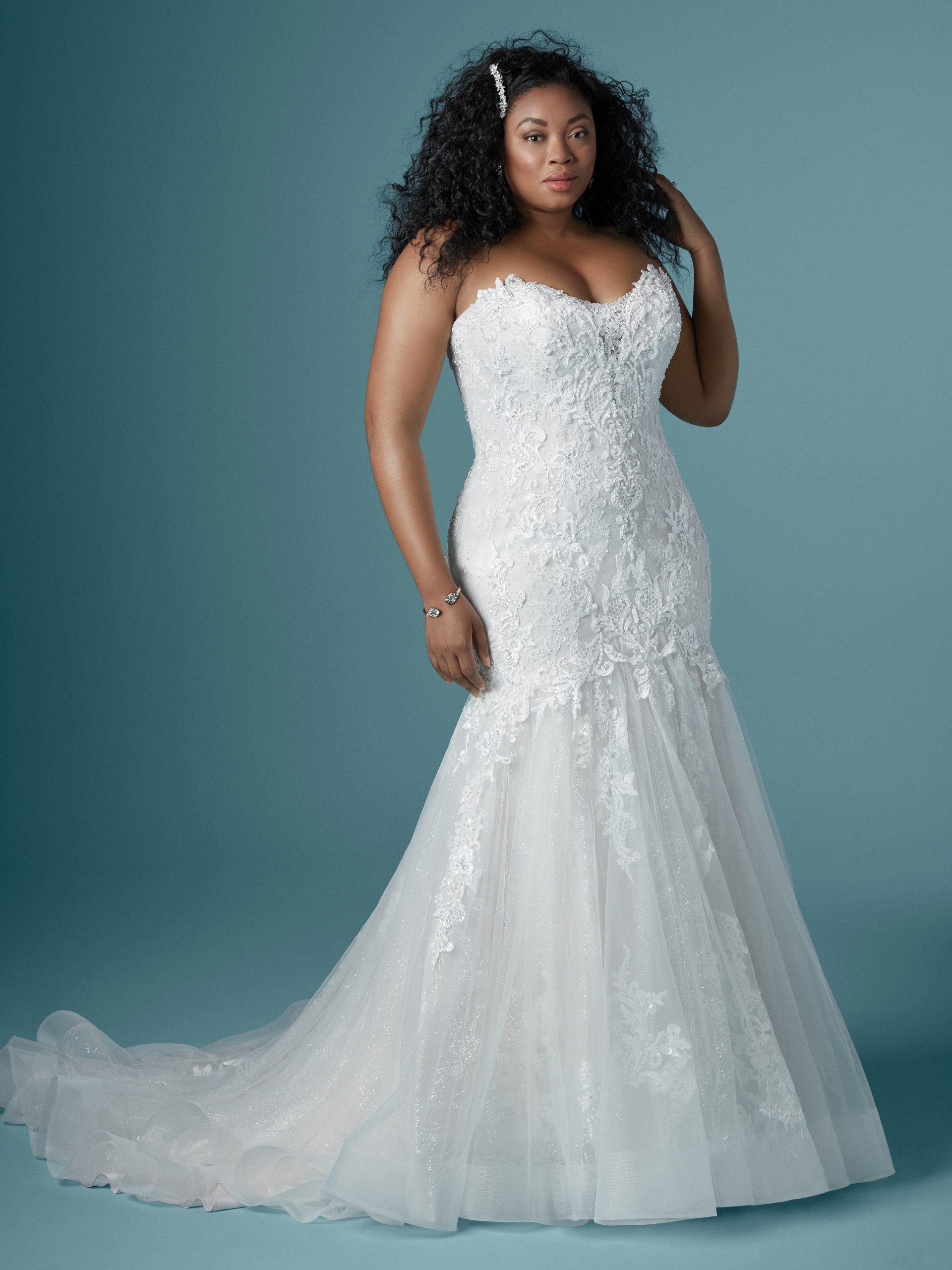 Model Wearing Plus Size Mermaid Wedding Gown Called Lonnie Lynette by Maggie Sottero