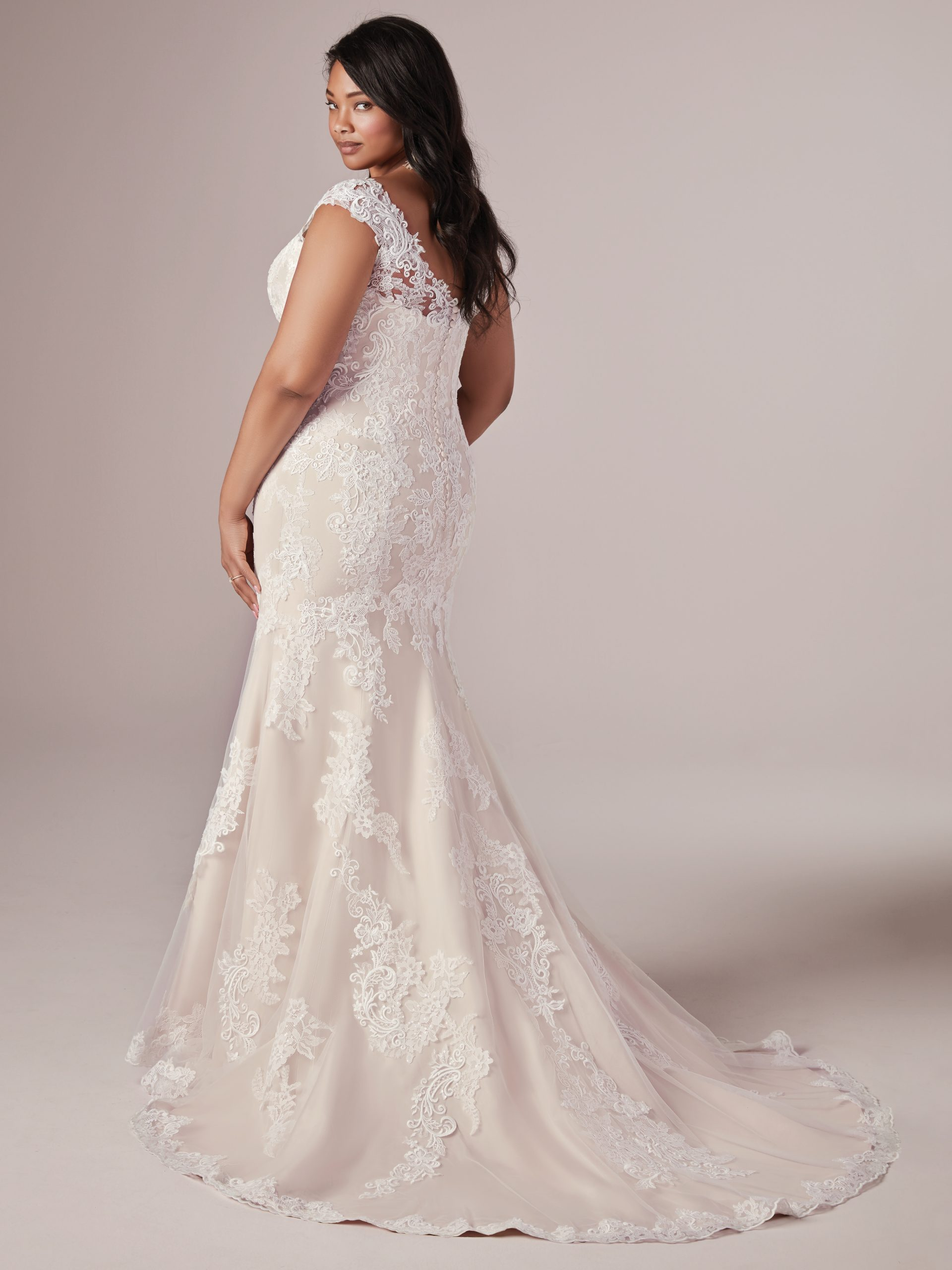 Plus Size Model Wearing Lace Fit and Flare Wedding Dress Called Daphne Lynette by Rebecca Ingram