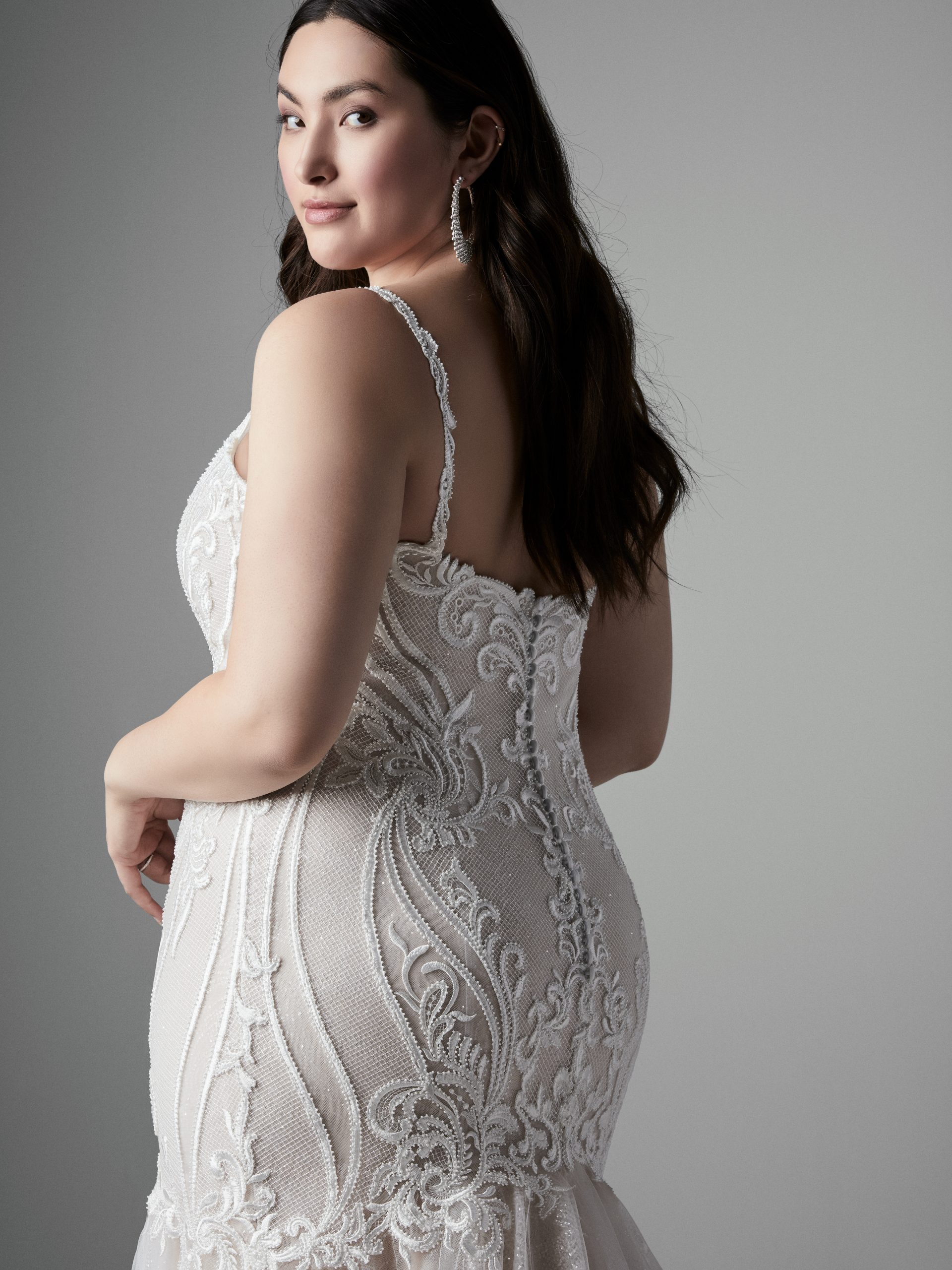 Model Wearing Plus Size V-neck Mermaid Wedding Gown Called Emmanuelle Lynette by Sottero and Midgley