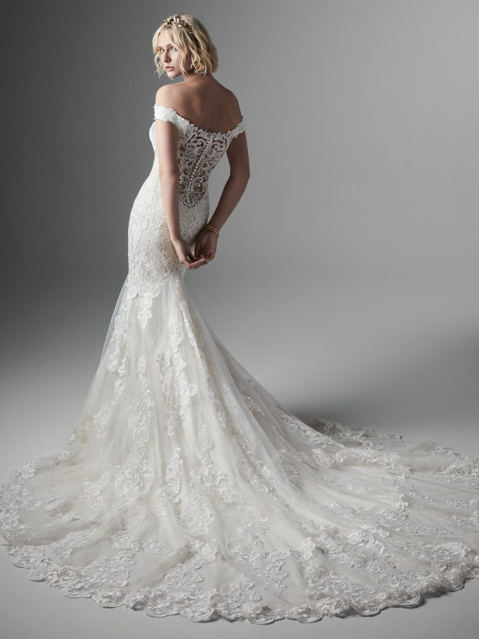 Bride Wearing Sweetheart Neckline Fit-and-Flare Wedding Dress Called Kennedy by Sottero and Midgley