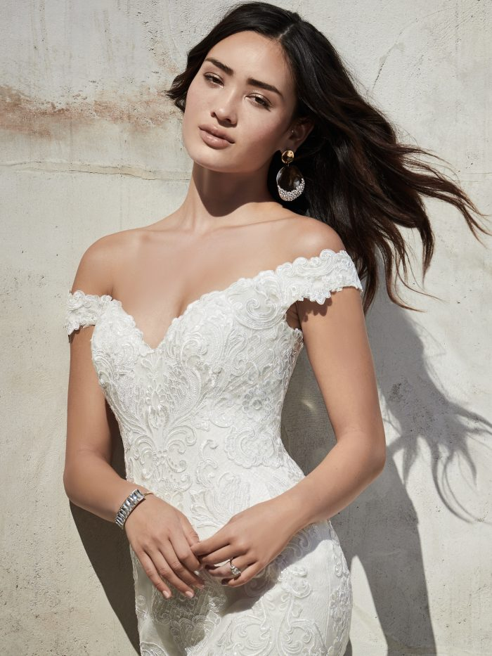 Bride Wearing Off-the-Shoulder Vintage Lace Wedding Dress Called Kennedy by Sottero and Midgley