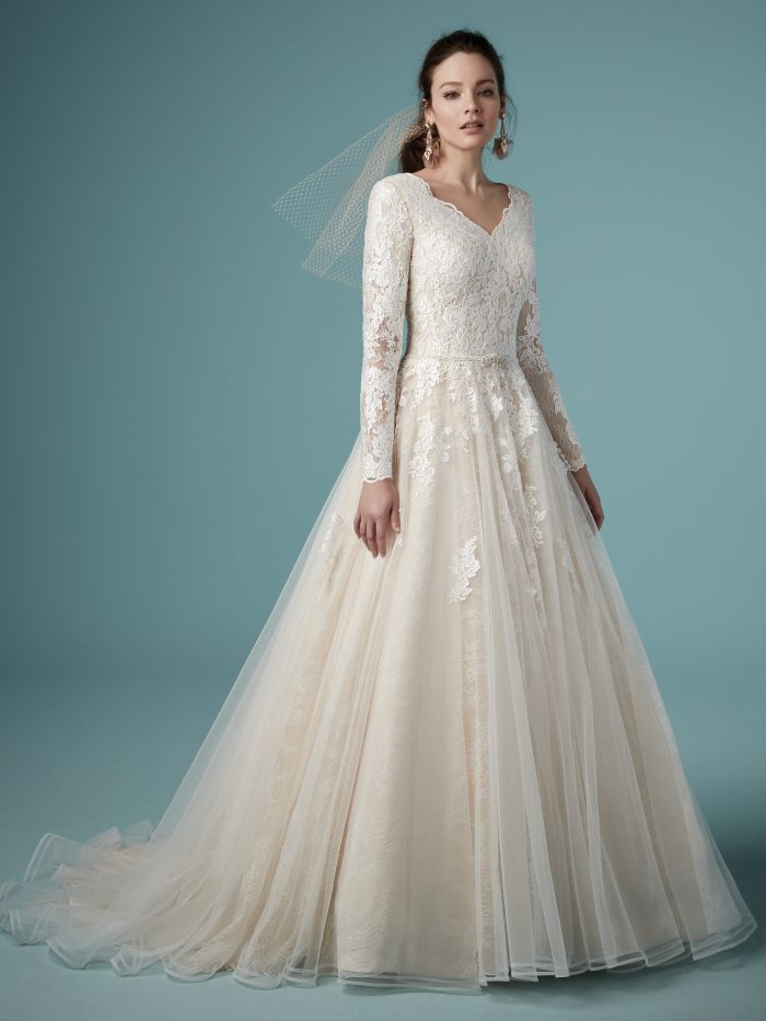 Model Wearing Unique Modest A-line Wedding Dress Called Shiloh Leigh by Maggie Sottero