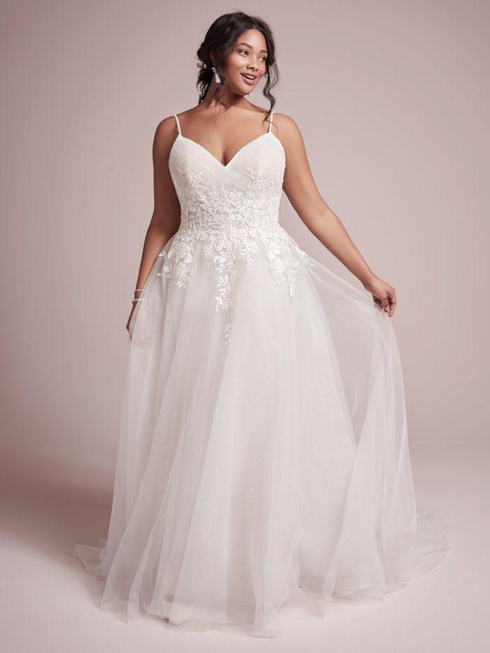 Curvy Model Wearing Plus Size Princess Wedding Gown Called Mila by Rebecca Ingram