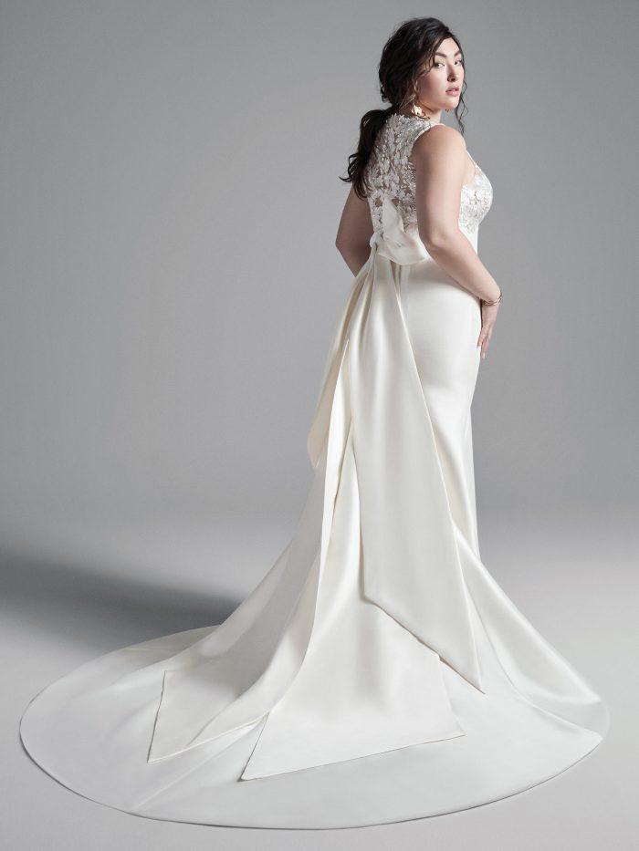 Plus Size Model Wearing Plus Size Mikado Sheath Wedding Dress Called Boden by Sottero and Midgley