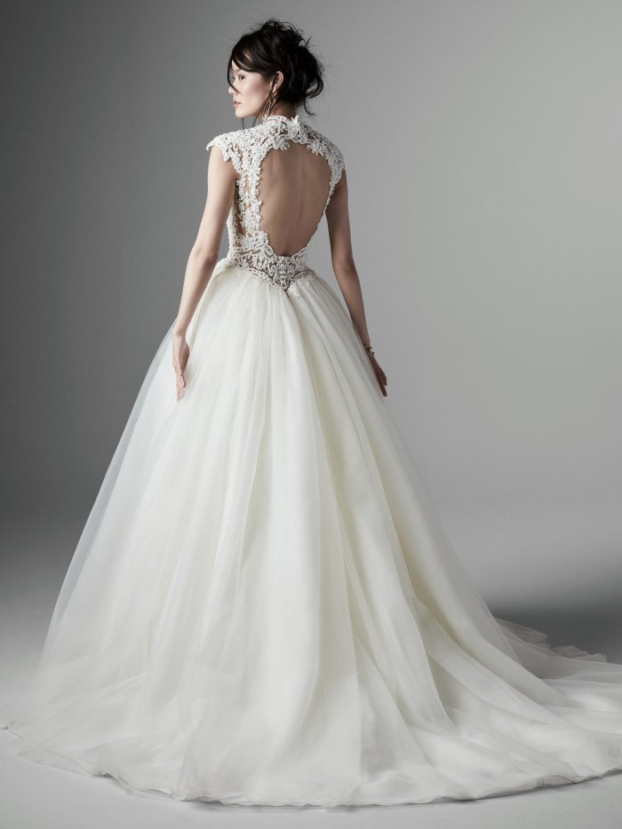 Model Wearing Keyhole Ball Gown Wedding Dress Called Zinnia Lane by Sottero and Midgley