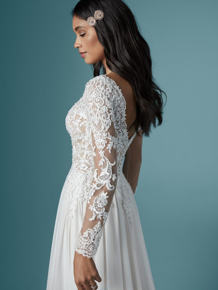 Bride Wearing Vintage Long Sleeve Lace A-line Wedding Gown called Madilyn by Maggie Sottero