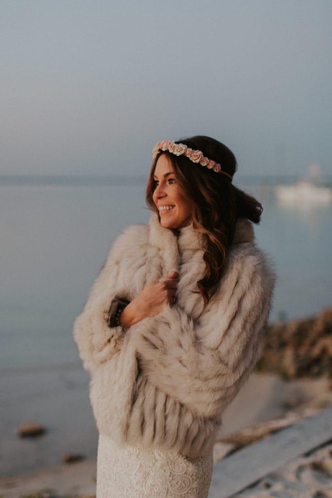 Real Bride Wearing Fur Coat Over Floral Boho Sheath Wedding Dress Called Hope by Rebecca Ingram