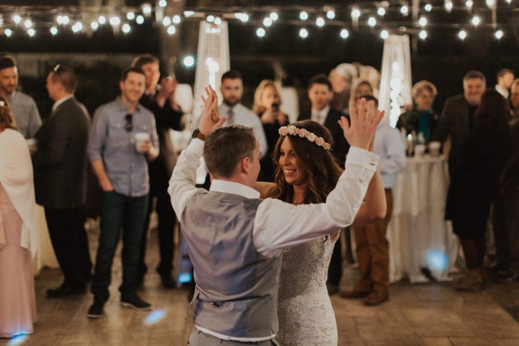 Groom Dancing with Bride During Outdoor Wedding Reception