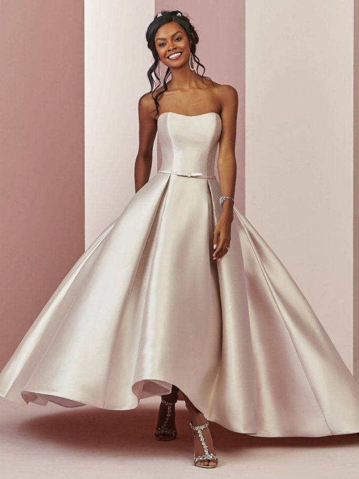 Bride Wearing Pink Satin Tea-Length Wedding Dress Called Erica by Rebecca Ingram