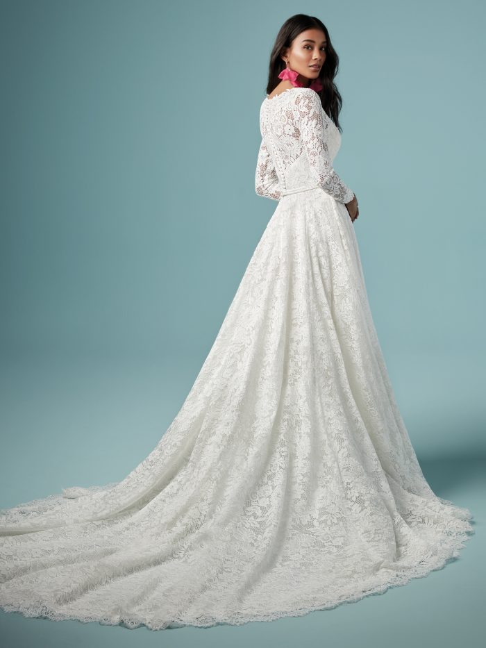 Model Wearing Long Sleeve A-line Wedding Gown Called Terry by Maggie Sottero