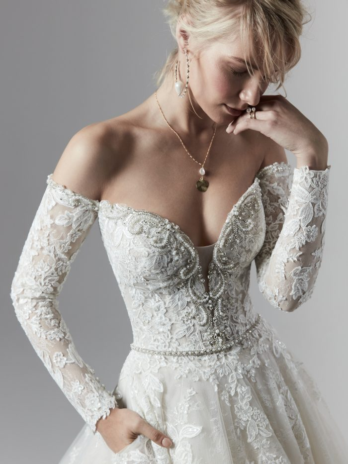 Model Wearing Long Sleeve Ball Gown Wedding Dress Called Porter Marie by Sottero and Midgley
