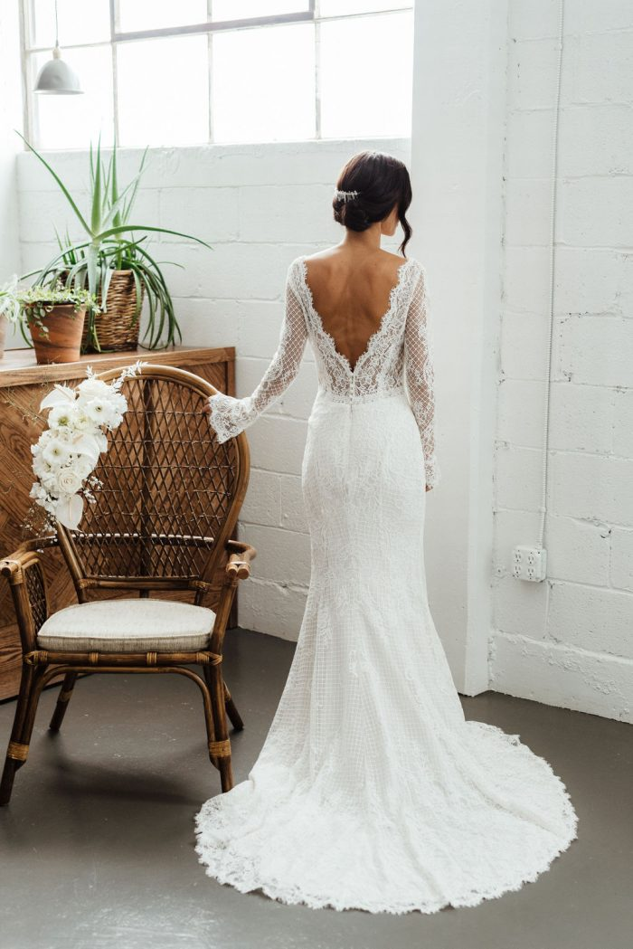 Bride Wearing Vintage-Inspired Lace Sheath Wedding Dress with V-back Called Antonia by Maggie Sottero