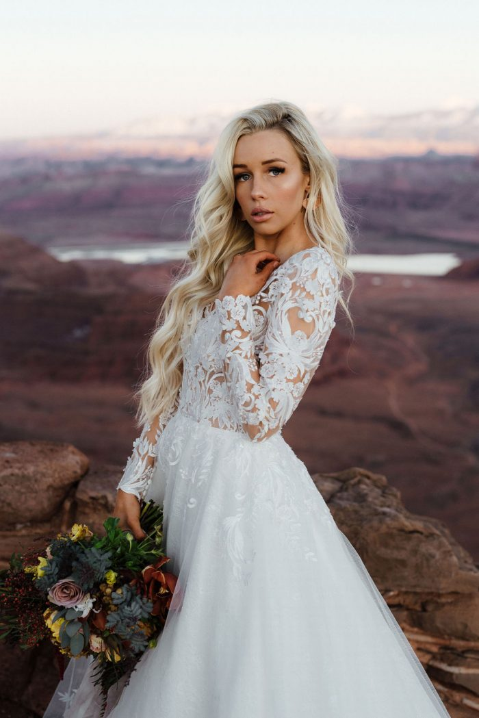 Model Wearing Long Sleeve Lace A-line Wedding Gown Called Zander by Sottero and Midgley
