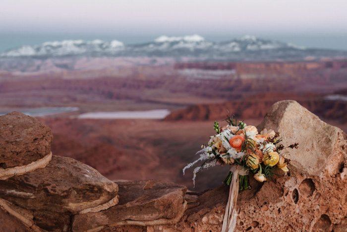Bouquet sitting on red rocks in Moab Utah