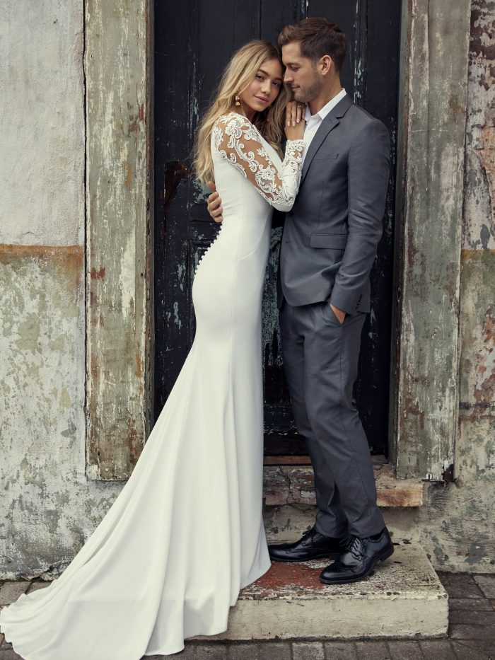 Groom with Bride Wearing Bethany Simple Lace and Crepe Wedding Dress by Rebecca Ingram