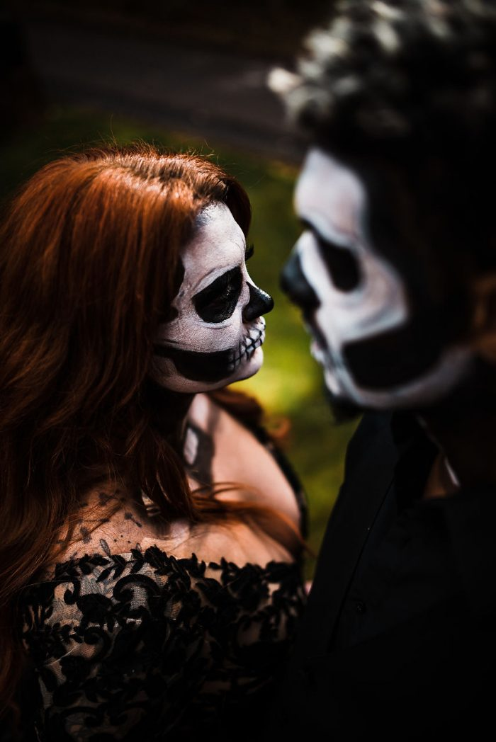 Bride and Groom Wearing Dramatic Skull Makeup for a Halloween Wedding