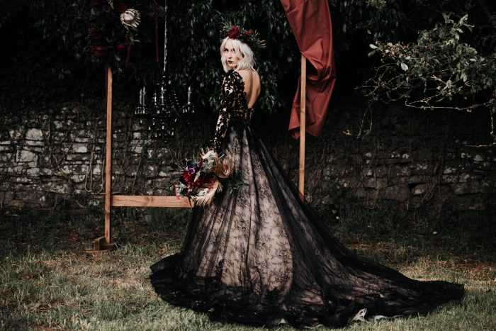 Real Bride Wearing Black Lace Wedding Gown and Holding Alternative and Moody Wedding Bouquet