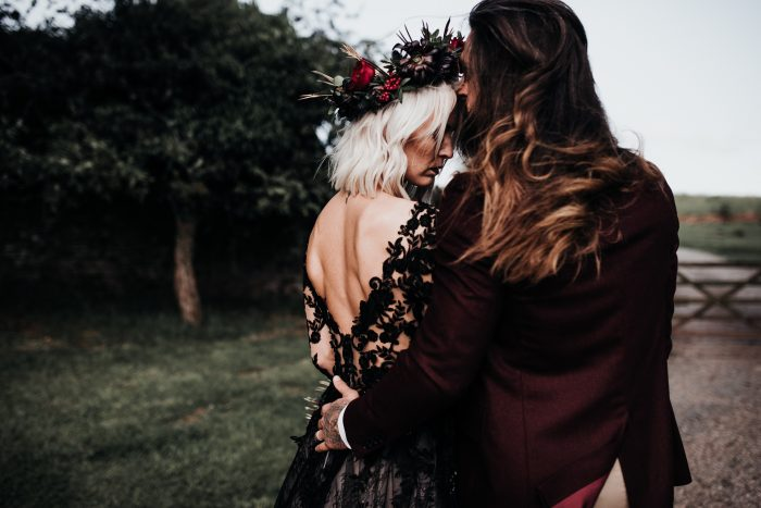 Groom with Bride Wearing V-back Black Lace Wedding Gown Called Zander by Sottero and Midgley