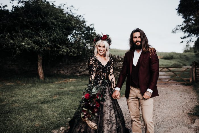 Gothic Bride Wearing Zander Black Wedding Dress by Sottero and Midgley with Groom Wearing Maroon Suit Coat