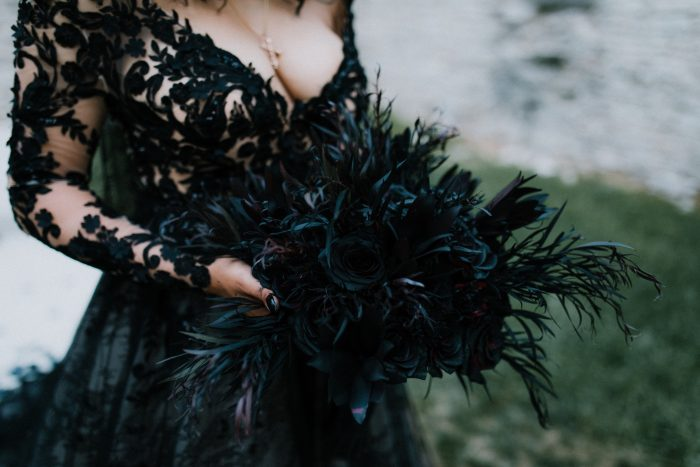 Bride Wearing Black Lace Wedding Dress by Maggie Sottero and Holding Alternative Black Bridal Bouquet