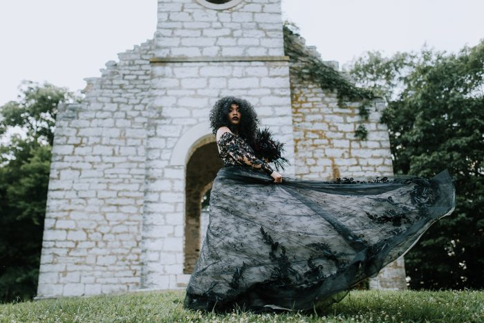 Real Bride Posing for Dramatic Wedding Portraits While Wearing Gothic Wedding Dress Called Zander by Sottero and Midgley