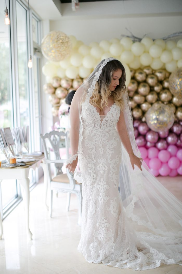 Real Bride Trying on Maggie Sottero Wedding Dress at Local Bridal Boutique