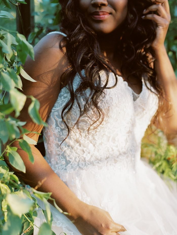 Close Up of Black Bride Wearing Lace Bodice A-line Wedding Gown Called Marisol by Rebecca Ingram