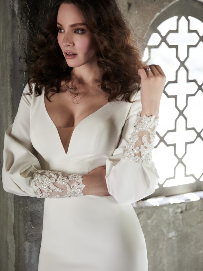 Model Wearing Bishop Sleeve Crepe Wedding Gown by Maggie Sottero