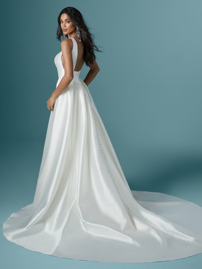 Model Wearing Striking Satin Wedding Dress with Attached Over Skirt Called Rhiannon by Maggie Sottero