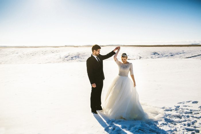 Groom with Real Bride Twirling and Wearing Ball Gown Wedding Dress Called Allen by Sottero and Midgley
