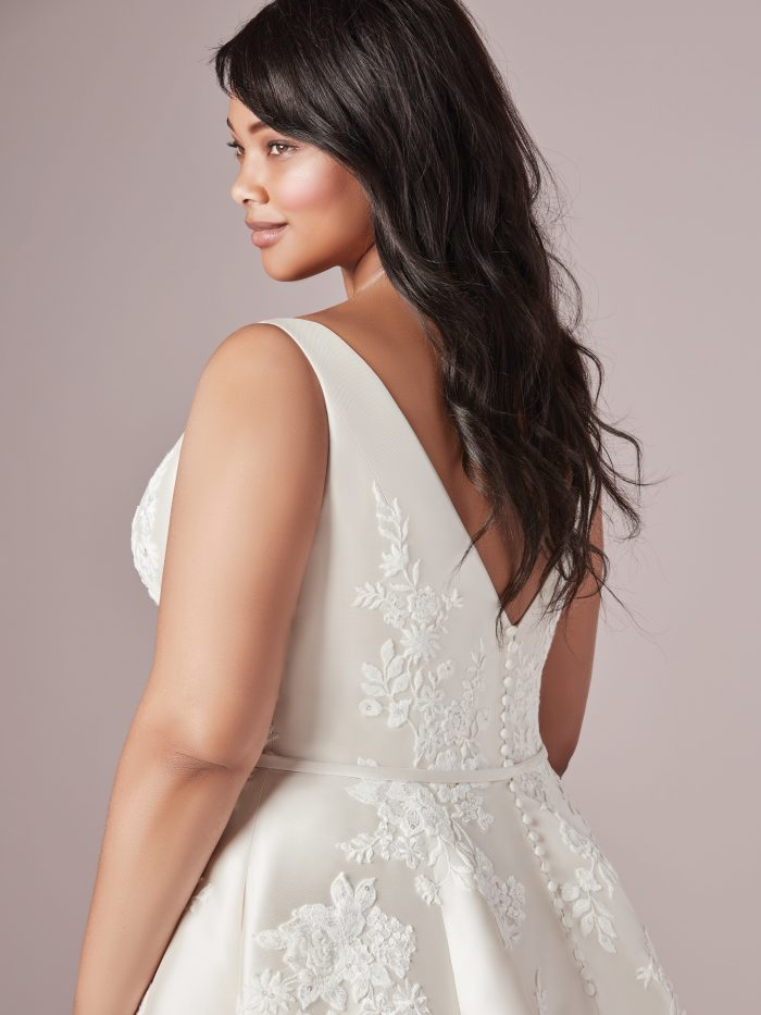 Latina Model Wearing Plus Size Satin Wedding Dress Called Valerie Lynette by Rebecca Ingram