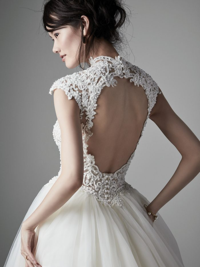 Model Wearing Tulle Ball Gown Wedding Dress with Keyhole Back Called Zinnia Lane by Sottero and Midgley
