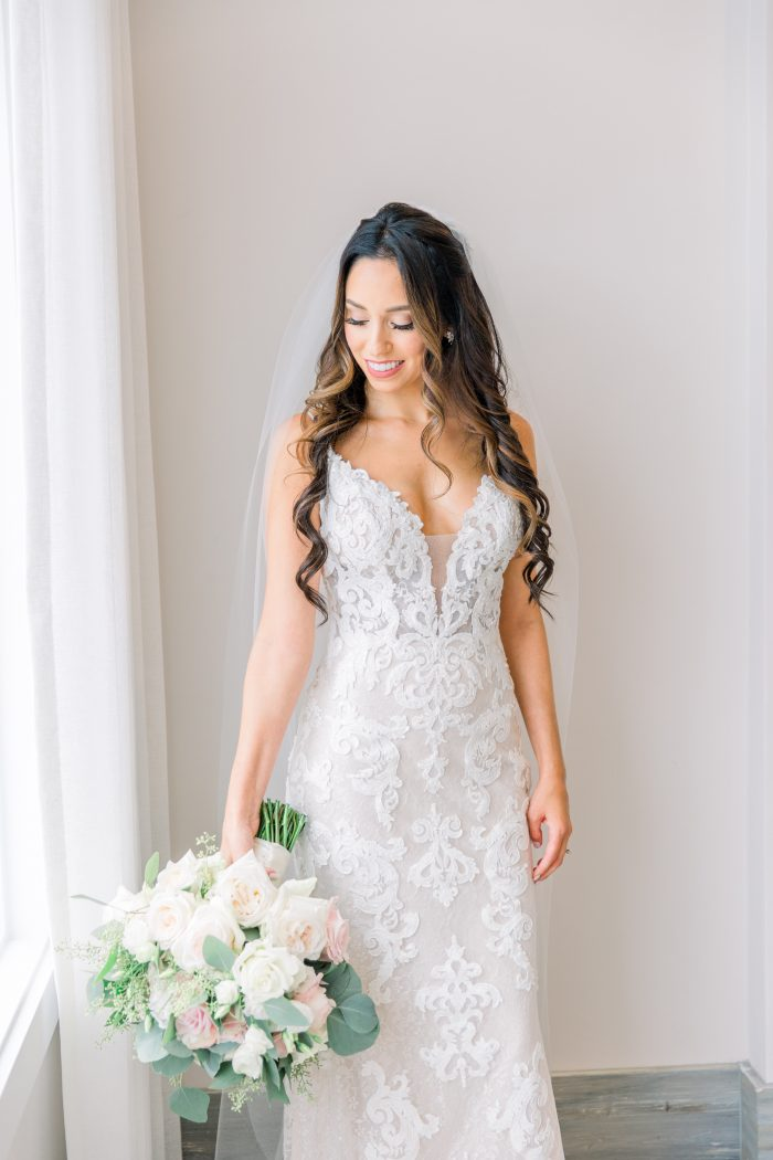Model Wearing Lace Wedding Gown with Sheer Bodice Called Tuscany Lynette by Maggie Sottero