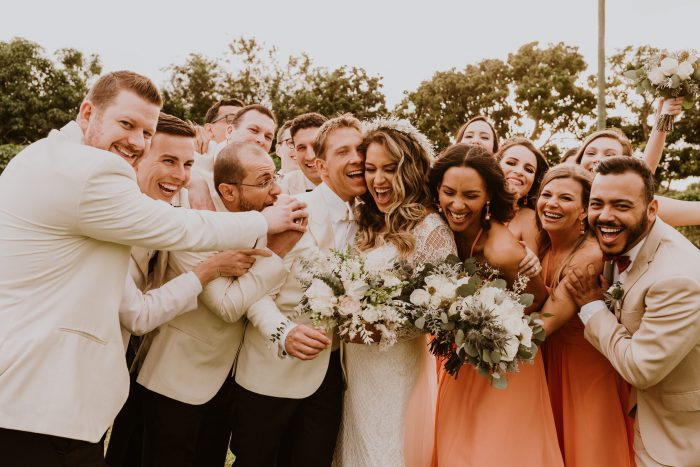 Groom with Real Bride Wearing Antonia Maggie Sottero Wedding Dress with wedding party