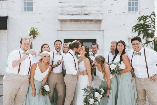 Charlene Wedding Dress Party with Couple Kissnig