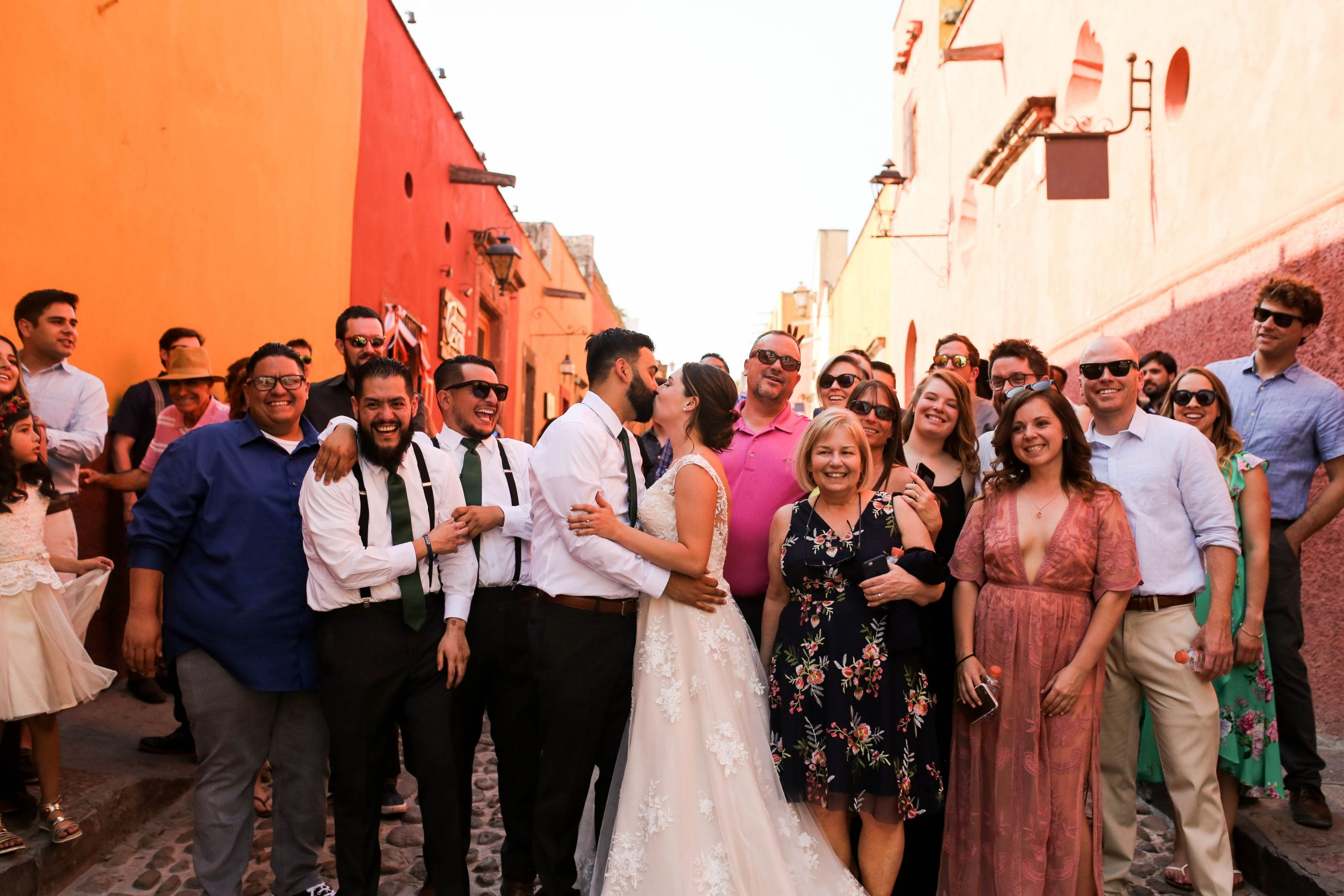 Groom Kissing Real Bride in Front of Wedding Party at Multicultural Wedding