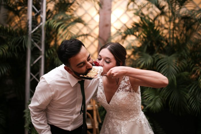 Real Bride and Groom Eating Tres Leches Cake