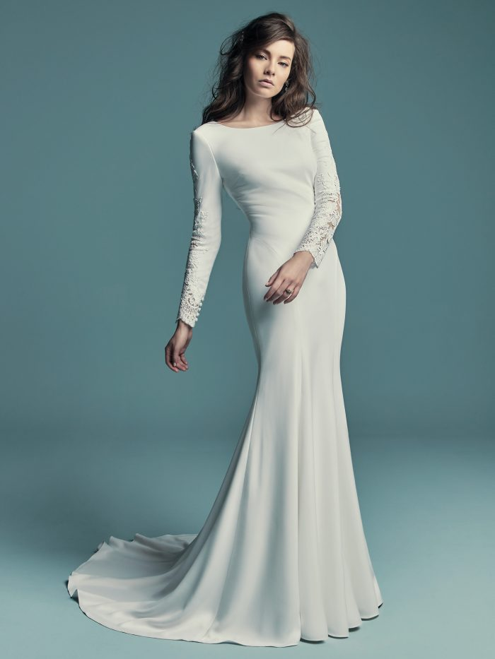 Bride Wearing Long Sleeve Sheath Bridal Gown Called Olyssia by Maggie Sottero